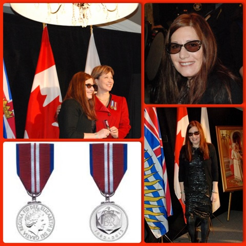 Suzi receiving the Queen Elizabeth II Diamond Jubilee Medal